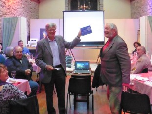 Graham Moss, Rotary Club, presented Trustee Kit Carter with a plaque. Rotary helped the purchase of new tables in the hall.